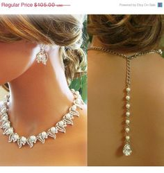 Bridal jewelry set, Bridal back drop bib necklace and earrings, vintage inspired crystal, pearl necklace statement, bridesmaid jewelry set. $84.00, via Etsy.