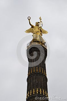 Golden angel statue on victory column berlin, germany.