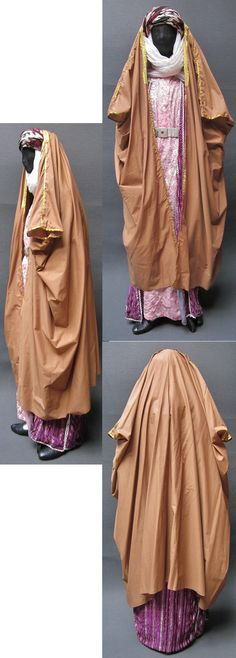Traditional  street wear from the Urfa province.  1990s, and still in use (2010s).  From the Arabic speaking village population of the region, who wears this costume during trips to the city.  The caftan, the head scarf and the outer coat were purchased in the Urfa Çarşısı (Covered Bazaar) in 1987; the dress with machine-embroidered front in Harran (1999).  (Kavak Folklor Ekibi & Costume Collection - Antwerpen/Belgium).