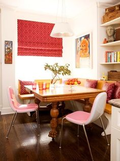 An antique dining table, retro-inspired modern chairs, and a classic banquette make a playful mix in this breakfast area. Faux-leather pads on the banquette and pillows made from laminated fabric lend easy care to the family- Kitchen Banquette, Dining Nook, Corner Banquette, Corner Table, Dining Bench, Corner Booth, Corner Seating, Kitchen Seating, Patio Dining