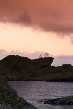 Clouds and lighthouse by Frederik Alexander Wik, via 500px
