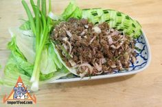 """Thai restaurants around the world sell larb (also spelled laab) in various styles, usually with ground chicken """"Larb Gai"""" or pork """"Larb Moo"""". Our Lao version here, made with rare lean ground beef, is exceptional because the meat soaks/cooks in lime juice for several hours then finished briefly in a skillet to give it an especially sour flavor. Combined with the shallots, sliced lemongrass, fish sauce and ground chiles, it all comes together so well. It's very healthy too. You can make this…"""