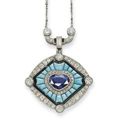 AN ART DECO SAPPHIRE, TURQUOISE AND DIAMOND PENDENT NECKLACE   Set with a heart-shaped sapphire and diamond cluster in a turquoise sunburst panel bordered by black enamel, to the diamond oval outer frame with raised diamond collet details, suspended from a diamond geometric link and fine link chain with diamond-set bar accents, mounted in platinum, circa 1930, 24.3 cm long
