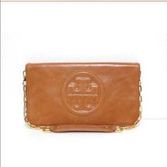Tory Burch Reva Bombe Clutch I've only worn this clutch twice Tory Burch Bags