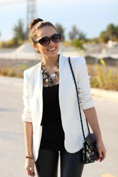 white blazer, black shirt and jeans