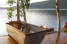 Just plain WOW with this Outdoor Bathtub and its setting!