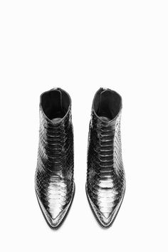 Zadig & Voltaire ankle boots with pointed toe. Metal zipper at the back with engraved pull and leather strap. Textured ZV rivet on the side of the upper and metal wings at the back of the heel. Leather sole, insole and lining. 60% python, 40% leather. True to size, select your usual size.