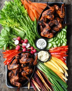 With just over a week to the big game, doing a little training for my chicken wing toss! Click to see me catch them all (unlike my previous #superbowl fumble!) 🍗🏈🤣  Chicken wings, veggies and dip... not a bad platter for game day! What's your favourite #gameday snack? #SuperBowl #GameDaySnacks #ChickenWings