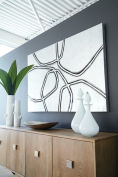 Would look nice in an entry way. Madero Console and Silver Rocks wall art