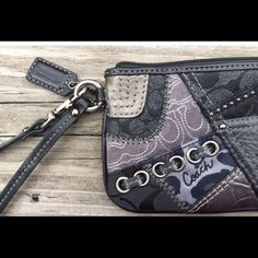 Authentic Coach Patchwork Wristlet Black leather, snake print and rivets make this perfect for any outfit! Coach Bags Clutches & Wristlets