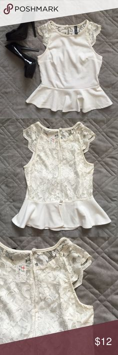 NWT Open-back Peplum Top NWT cream colored peplum top. Features see-through lace on cap sleeves and open-back, three-button back closure. Tops Blouses