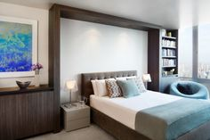 I like the bookshelf that was added here.  Residence contemporary bedroom
