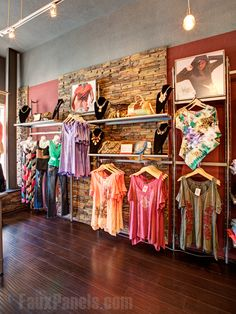 Our faux stone is a great looking backdrop for showcasing their products and, when placed near checkout counters, it also withstands heavy wear and tear. That's what Shakabuku Designs found when they chose our Drystack Earth siding panels. This charming boutique has a full line of clothing and specializes in custom embroidery, so they wanted something that would work well with their design aesthetic. http://www.fauxpanels.com/img_c/14-wellington/design/257.jpg…