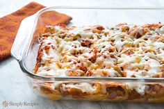 Family favorite, Tex Mex cheese enchiladas recipe.  Corn tortillas, lightly fried, rolled up with Jack or cheddar cheese, arranged in a casserole dish, covered with tomato and green chile sauce, and baked. ~ SimplyRecipes.com