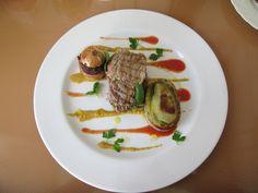 Vitello  farcito di lattuga e olive  ,cipolla  in farcia di  olive e  patata  alle olive  di  bietola  verde,   salsa  gazpacho e pomodoro Gino D'Aquino