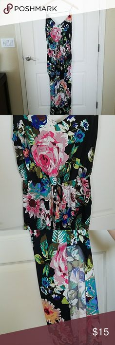Tropical floral Maxi dress Black with tropical floral pattern, ties at waist, thigh high slit on right leg, so cute and light for summer, addition strap goes across back, purchased from boutique and never wore Dresses