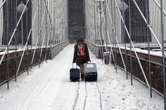 A man walks with his luggage over the Brooklyn Bridge in the snow on March 5, in New York City.  ::  The Week in Pictures: Feb. 26 - March 5 - NBC News.com
