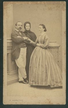 Interesting trio - Dad, Mom, and daughter?  Or Mom keeping eye on the romance between older man and younger daughter?  Either way, the woman in the middle doesn't look particularly friendly.