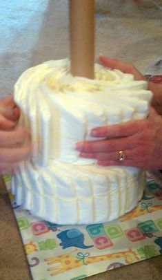 Diaper Cake Without Rolling Diapers | using a cake pan for shaping we made the bottom tier with 30 diapers ...