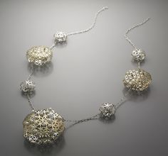 "Necklace by Young Joo Yoo. ""The laurel flake""  Sterling silver, 18k gold (bi metal), pearls."