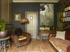 Dark vintage: Gunship grey is a great foil for decorative antiques. Try Farrow & Ball's Downpipe for a similar shade. Rose & Grey sells similar vintage leather furniture, and for a lampshade like this one, try BeauVamp at Not On The High Street. Or go to Zoe Darlington.