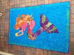 Mermaid quilt for Sydney's 3rd birthday.  Inspired by Top of the Range Designs.  Quilted by Helia Ricci.  7/2012