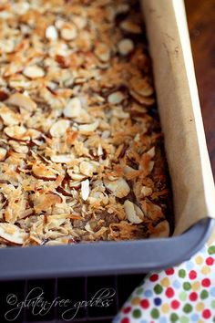 Gluten Free Raspberry Bars topped with buttery toasted almonds and coconut!