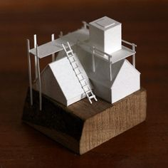 Hand made paper model, cabin construction, on a wooden base. Completely drawn, cut and assembled by hand from acid-free watercolour paper.    Model