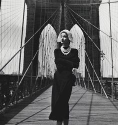 Brooklyn Bridge, New York.  Photo by Louise Dahl-Wolfe for Harper's Bazaar 1947.   Dahl-Wolfe is credited with influencing some of fashion photography's greatest names including Richard Avedon and Horst P.Horst.♛   ♛~✿Ophelia Ryan ✿~♛