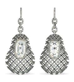 A PAIR OF SPECTACULAR DIAMOND EAR PENDANTS, BY JAR  Each set with a rectangular table-cut diamond weighing 9.72 and 7.68 carats to the pear-shaped ear pendant of diamond-set cage design and diamond link surmount, created in 2005, 9.0 cm. long, in JAR red leather case Price Realised   USD 576,000 Estimate USD 500,000 - USD 700,000