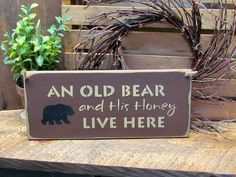 """Front Door Decor, Wooden Sign for the Home. This wooden welcome sign is made from pine, and measures Approx 5.5""""W x 13""""L. It reads """"An Old Bear And His HOney Live Here"""". The front is painted an Espres"""