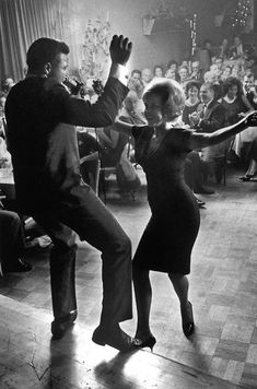 "Chubby Checker dancing with a fan in 1961. Photography by Ralph Crane. ""Chubby Checker has never been properly acknowledged for one major contribution to pop culture—Chubby and the Twist got adults out and onto the dance floor for the first time. Before the Twist dance phenomenon, grown ups did not dance to teenage music."" ~disc jockey Clay Cole"