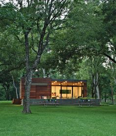 In a family's pint-size lake retreat in Austin, Texas, ipe siding and decking meet concrete floors and steeland-glass windows. Stained cy...