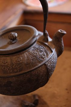 Japanese iron tea kettle.... I really like Oriental pottery, and china. Very pretty.