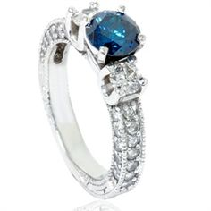 Item #: ENG8649BLE      Width: 3 mm      Weight: 6.9 g      Metal: 14k White Gold      Diamond Cut: Round      Diamond Color: G/H      Diamond Clarity: I1      Diamond Carat: 2      Diamond Quantity: 41      Diamond Setting: Prong    This womens ring features a 1.00ct blue color enhanced diamond and .25ct accent diamonds. All diamonds are prong set in a solid 14k white gold.  $1999