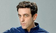 BJ Novak looking sideways at the camera with a glint in his eye