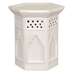 A ceramic garden stool in bright white can be used as extra seating or a side table in an outdoor area.   $175