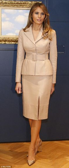 Melania looked elegant in a tan skirt suit and Manolo Blahnik snakeskin heels, the same outfit she wore to visit a children's hospital during the day