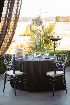 Black Chiavaris and Glass Beaded Charges helped at to the Great Gatsby themed table - see more at http://www.grandeventrentalswa.com/