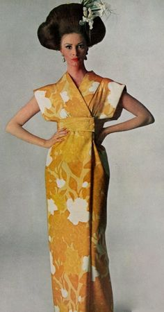 1965 Model Wilhelmina Cooper is wearing a creation by Norman Norell.She was Photographed by Penn.Vogue,April