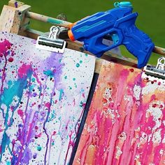 Kids Art Ideas - Hours of fun in the garden! Kids will love this painting idea from The Wooden Toy Box. All you need is a water pistol or old drink bottle and some paints you have at home. Or why not make our easy non toxic water colour paints recipe instead - #kids #painting #painting #children #toddlers #preschoolers #kidsactivities #kids art #gardenkids