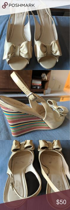 Kate Spade Rainbow Wedge Heels Gently loved rainbow heels from Kate Spade. The heel is about 3.5 inches, and because it is a wedge they are very comfortable. They've been sitting untouched in a shoe box for the last 2 years and I'd love to get them to a good home with a fashionable mama! kate spade Shoes Wedges