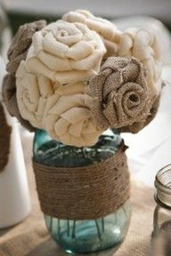 Burlap flowers in Mason Jars. The possibility with these things are endless!