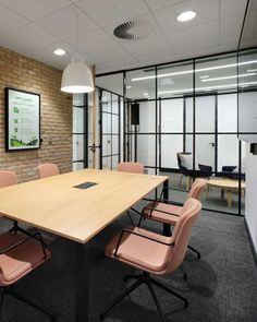 On-trend Meeting Rooms | Office Design by Morgan Lovell | Black framed windows, exposed brick walls and dusky pink furniture make this a stunning meeting room. #OfficeInteriorDesign Pink Furniture, Furniture Making, Innovative Office, Building Society, Exposed Brick Walls, Meeting Rooms, Banquette Seating, Waiting Area, Contemporary Office