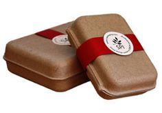GreenKraft clamshells with red wrap around paper sleeves and printed labels.  Great idea for corporate branded gifts.