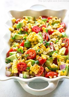 Corn Avocado and Tomato Salad - a healthy and light salad perfect for BBQs and get togethers. the-girl-who-ate-everything.com