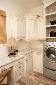 These rustic cabinets are gorgeous and you need all the space you can get in a laundry room!