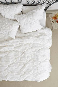 WHITE! Don't you just want to curl up? (Anthropologie - Bedroom)