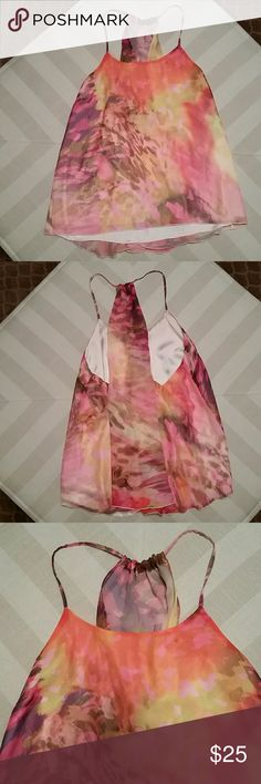 JENNIFER LOPEZ  SPRING TOP JENNIFER LOPEZ RACERBACK  HIGH/LOW TOP SIZE LARGE  MULTI SPRING AND SUMMER COLORS  BUST 18 INCHES LAYING FLAT  LENGTH IN FRONT 26 INCHES BACK LENGTH 30 INCHES COMPLETELY LINED 100% POLYESTER WORN ONCE GREAT CONDITION! Jennifer Lopez Tops Tank Tops
