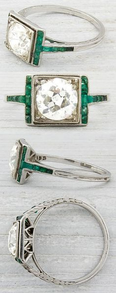 Art Deco engagement ring with calibre emerald accents and a 1.20 carat EGL certified old European cut diamond with J-K color and SI1 in clarity.